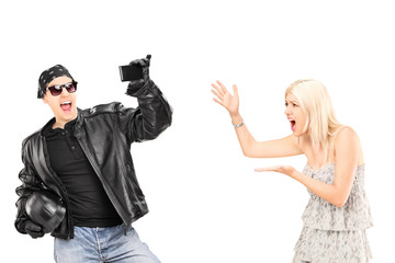 Mad woman yelling at her biker boyfriend