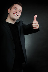 Young man gesturing the ok sign