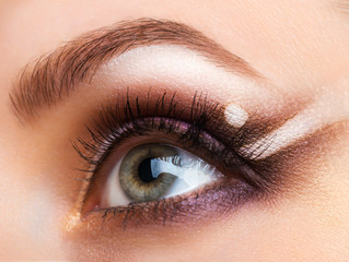 Closeup of womanish eye with glamorous makeup