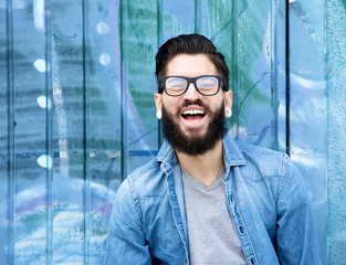 Young man with beard laughing
