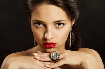 Young beautiful girl in beautiful jewelry