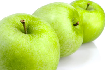 Three green apples in a row