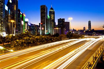 Modern city traffic at night in Hong Kong