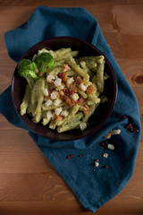 pasta broccoli salmon pink pepper and crumble bread