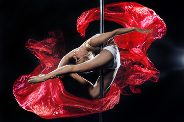 pole dance woman with red silks Wall mural
