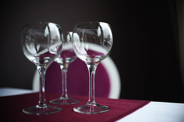 Empty wine glasses on table at a restaurant