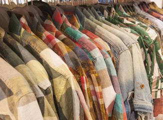 Mens shirts hanging on a rail