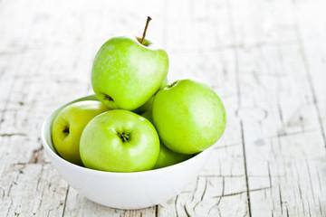 ripe green apples in bowl