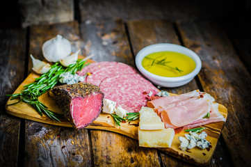Chopping board of Assorted Cured Meats, Cheese and Honey with ro