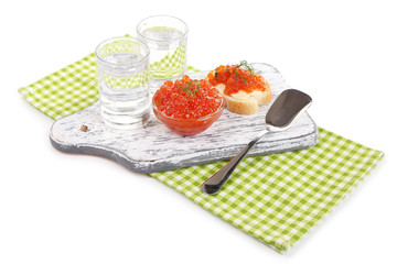 Red caviar in bowl and vodka