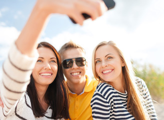 friends taking picture with smartphone camera