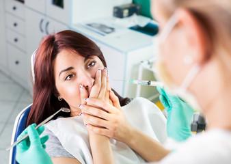 Scared girl at dentist