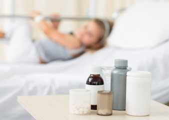 Medicines on table with girl in hospital