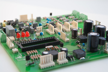 Electric charge, chips. Green electronic circuit.