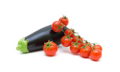ripe tomatoes and eggplant on a white background