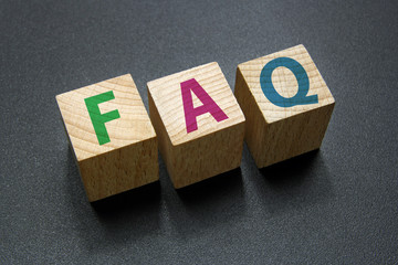 faq text on wood cubes