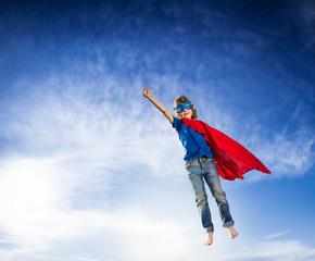 Superhero kid flying
