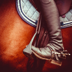 Poster de jardin Equitation jockey riding boot, horses saddle and stirrup