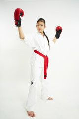 young taekwondo girl with red boxing glove