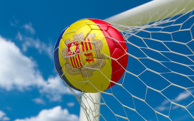 Flag of Andorra and soccer ball in goal net