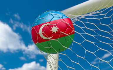 Flag of Azerbajan and soccer ball in goal net