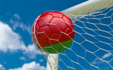 Flag of Belarus and soccer ball in goal net