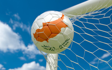 Flag of Cyprus and soccer ball in goal net