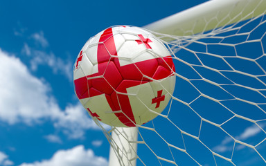 Flag of Georgia and soccer ball in goal net