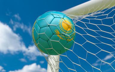 Flag of Kazakhstan and soccer ball in goal net