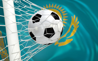 Flag of Kazakhstan and soccer ball in goal net