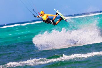jumping kitesurfer on sea background Extreme Sport Kitesurfing