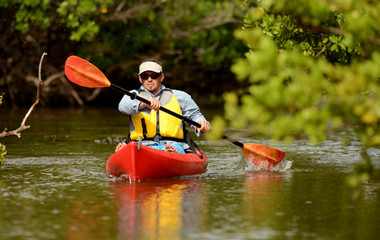 Man paddling in a kayak in Florida