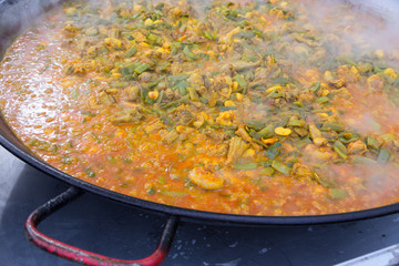 Cooking paella typical from Valencia Spain recipe with rice