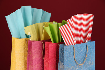 Colorful shopping bags, on dark color background