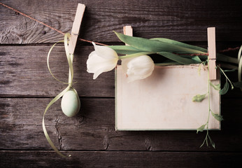 easter egg and paper attach to rope with clothes pins and tulips
