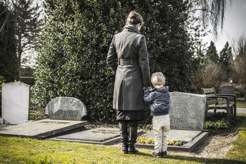 mother and child at graveyard Wall mural
