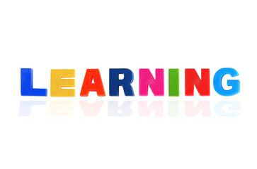 LEARNING written In Multicolored Plastic Kids Letters