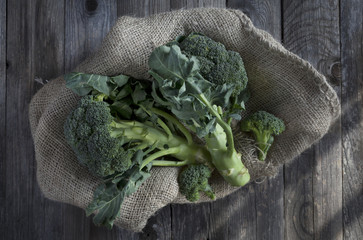 broccoli on jute sack on woody and rustic table