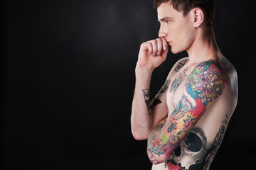 handsome young man covered with tattoo.