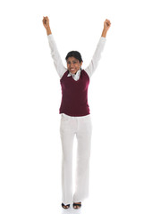 Successful businesswoman celebrates with her arms up in victory,