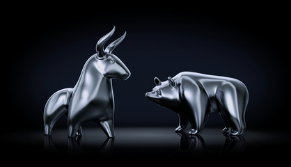 Metallic statuettes of a bull and a bear as stock market players