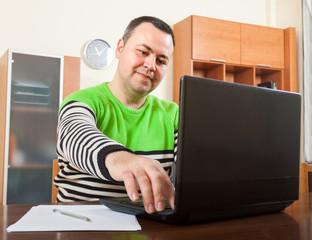 man sitting at his laptop
