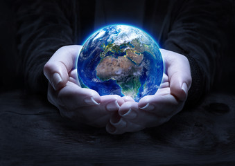 Wall Mural - earth in hands - environment protection concept