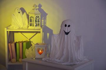 Halloween ghosts, on home interior background