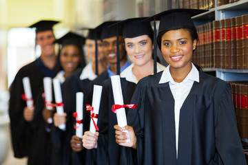 group of graduates in library