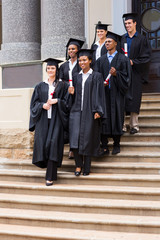 young graduates walking down the stairs