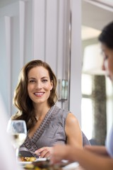 Woman having wine with a friend at restaurant