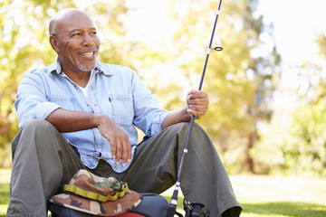 Senior Man On Camping Holiday With Fishing Rod