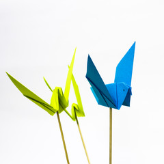 Origami bird with stick bottom it to look like it fly.