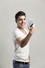 young attractive man taking self pictures wit his phone